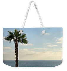Weekender Tote Bag featuring the photograph Palm Over The Sea by Brian Eberly