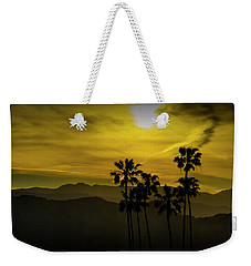 Weekender Tote Bag featuring the photograph Palm Trees At Sunset With Mountains In California by Randall Nyhof