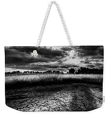 Weekender Tote Bag featuring the photograph Parched Prairie by Dan Jurak