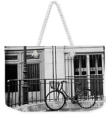 Weekender Tote Bag featuring the photograph Paris Black And White Architecture Windows Street Lanterns Bicycle Print - Paris Street Lanterns by Kathy Fornal