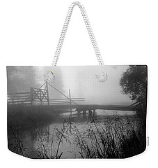 Part Of The Snake River Passes Under A Wooden Bridge Weekender Tote Bag by Wernher Krutein