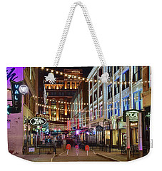 Weekender Tote Bag featuring the photograph Party Off Prospect by Frozen in Time Fine Art Photography