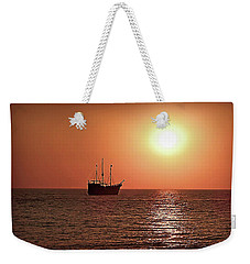 Weekender Tote Bag featuring the photograph Passing By In Calm Waters by Joan  Minchak