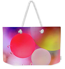 Weekender Tote Bag featuring the photograph Pastel Oil Bubble Water Drops by John Williams