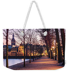Weekender Tote Bag featuring the photograph Path By A Pond - The Hague by Barry O Carroll