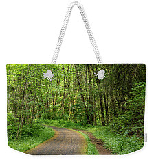 Weekender Tote Bag featuring the photograph Path Through The Woods by Jean Noren