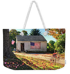 Weekender Tote Bag featuring the photograph Patriotic Barn With Flag In Autumn by Joann Vitali