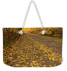 Weekender Tote Bag featuring the photograph Paved In Gold by Steve Stuller