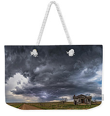 Weekender Tote Bag featuring the photograph Pawnee School Storm by Darren White