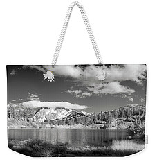 Weekender Tote Bag featuring the photograph Peaceful Lake by Jon Glaser