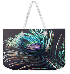 Peacock Feather In Sun Light Weekender Tote Bag by Angela Murdock