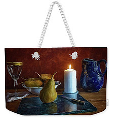 Weekender Tote Bag featuring the photograph Pears By Candlelight by Mark Fuller