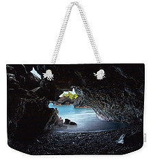 Weekender Tote Bag featuring the photograph Peeking Through The Lava Tube by Susan Rissi Tregoning