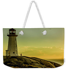 Peggys Cove Lighthouse At Sunset  Weekender Tote Bag by Ken Morris