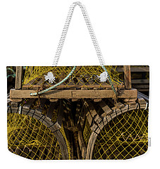 Weekender Tote Bag featuring the photograph Pei Loberster Traps With Yellow Netting by Chris Bordeleau