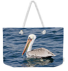 Weekender Tote Bag featuring the pyrography Pelican At Sea by Shoal Hollingsworth