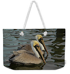 Weekender Tote Bag featuring the photograph Pelican Duo by Jean Noren