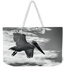 Pelican In Flight Weekender Tote Bag by AJ Schibig