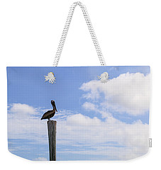 Pelican In The Clouds Weekender Tote Bag by Christopher L Thomley