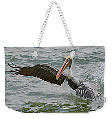 Weekender Tote Bag featuring the photograph Pelican Take Off by Jimmie Bartlett