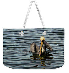 Weekender Tote Bag featuring the photograph Pelican Wing In A  Twist by Jean Noren
