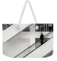 Weekender Tote Bag featuring the photograph People Divided by John Williams