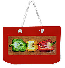Weekender Tote Bag featuring the photograph Peppers In A Row By Kaye Menner by Kaye Menner