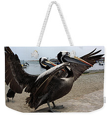Weekender Tote Bag featuring the photograph Peruvian Pelicans by Aidan Moran