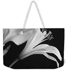 Weekender Tote Bag featuring the photograph Petals' Light by Eric Christopher Jackson