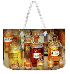 Weekender Tote Bag featuring the photograph Pharmacy - Serums And Elixirs by Mike Savad