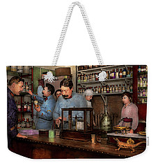Weekender Tote Bag featuring the photograph Pharmacy - The Dispensing Chemist 1918 by Mike Savad