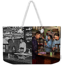 Weekender Tote Bag featuring the photograph Pharmacy - The Dispensing Chemist 1918 - Side By Side by Mike Savad