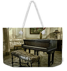 Weekender Tote Bag featuring the photograph Piano At Josie's House by Joan Carroll