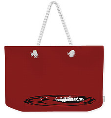 Weekender Tote Bag featuring the digital art Piccolo In Orange Red by Jazz DaBri