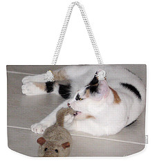 Weekender Tote Bag featuring the photograph Pico And Toy Mouse by Phyllis Kaltenbach