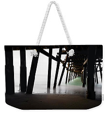 Weekender Tote Bag featuring the photograph Pier Pressure by Sean Foster