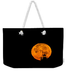 Weekender Tote Bag featuring the photograph Pierhead Supermoon Silhouette by Everet Regal
