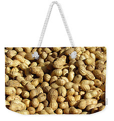 Weekender Tote Bag featuring the photograph Pile Of Peanuts by Bonnie Muir