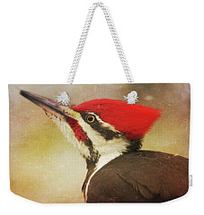 Weekender Tote Bag featuring the photograph Pileated Woodpecker With Snowfall by Heidi Hermes