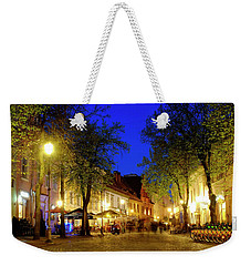 Weekender Tote Bag featuring the photograph Pilies Street by Fabrizio Troiani