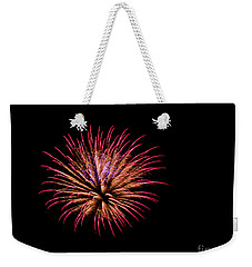 Weekender Tote Bag featuring the photograph Pink And Orange Fireworks by Suzanne Luft