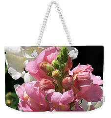 Weekender Tote Bag featuring the photograph Sweet Peas by Eunice Miller