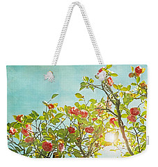 Pink Camellia Japonica Blossoms And Sun In Blue Sky Weekender Tote Bag