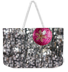 Weekender Tote Bag featuring the photograph Pink Christmas Bauble by Ulrich Schade