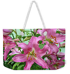 Weekender Tote Bag featuring the photograph Pink Lilies by Jay Milo