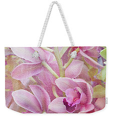 Weekender Tote Bag featuring the photograph Pink Orchids by Ann Bridges