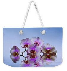 Pink Orchids Blue Background Weekender Tote Bag