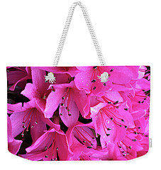 Weekender Tote Bag featuring the photograph Pink Passion In The Rain by Sherry Hallemeier