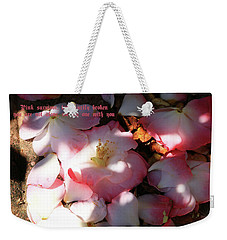 Weekender Tote Bag featuring the photograph Pink Survivor by Dennis Baswell