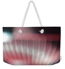 Weekender Tote Bag featuring the photograph Pink Swirl by Allen Beilschmidt